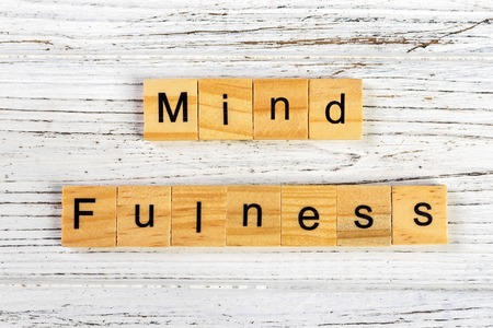 mindfulness made with wooden blocks concept. Yoga, succeed, open-minded.