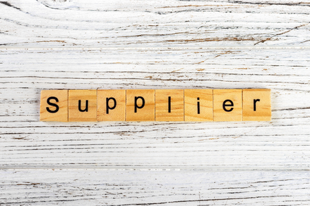 SUPPLIER word made with wooden blocks concept Stock Photo