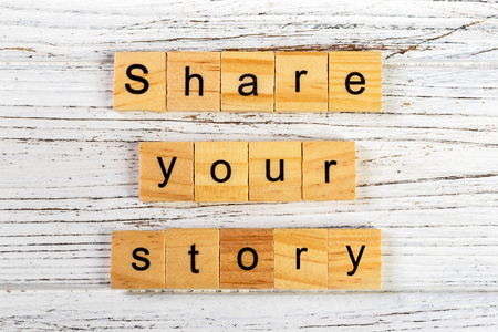 share your story word made with wooden blocks concept