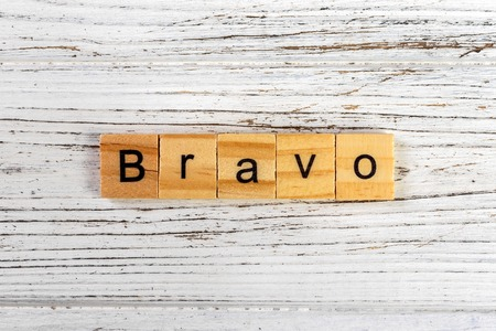 BRAVO word made with wooden blocks concept Banco de Imagens - 86104758