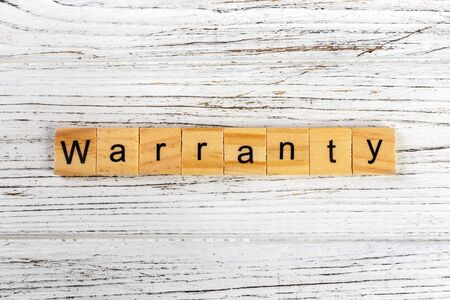 Warranty word made with wooden blocks concept