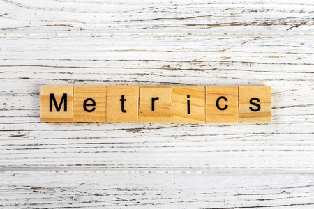 METRICS word made with wooden blocks concept Archivio Fotografico