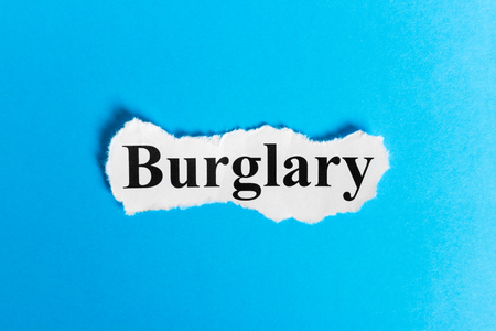 BURGLARY text on paper. Word BURGLARY on a piece of paper. Concept Image. Stock Photo