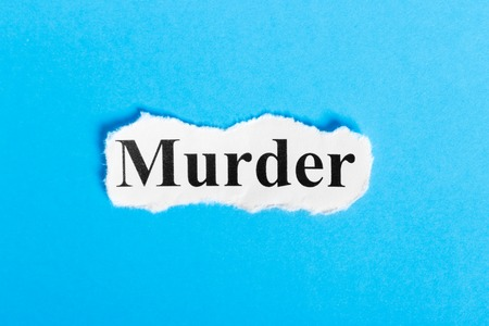 heist: Murder text on paper. Word Murder on a piece of paper. Concept Image. Stock Photo