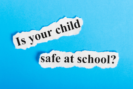 is your child safe at school text on paper. Words is your child safe at school on a piece of paper. Concept Image.