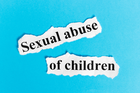 Sexual abuse of children. Words sexual abuse of children on a piece of paper. Concept Image.