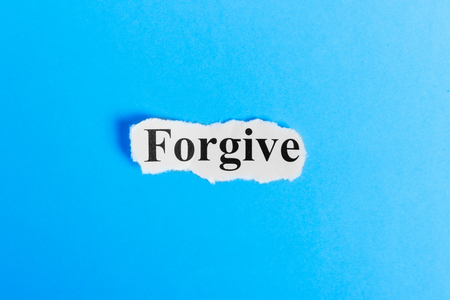 Forgive text on paper. Word Forgive on a piece of paper. Concept Image. Stock Photo