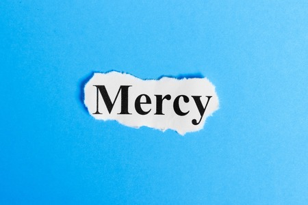 mercy text on paper. Word mercy on a piece of paper. Concept Image. 免版税图像