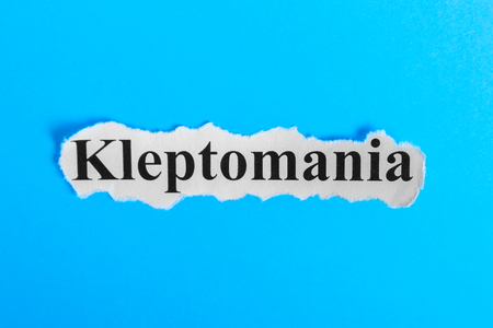 Kleptomania text on paper. Word Kleptomania on a piece of paper. Concept Image. Kleptomania Syndrome. Stock Photo