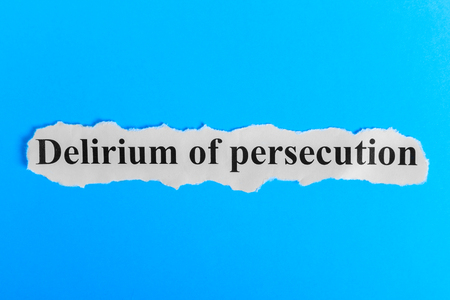 Delirium of persecution text on paper. Word Delirium of persecution on a piece of paper. Concept Image. Delirium of persecution Syndrome. Stock Photo