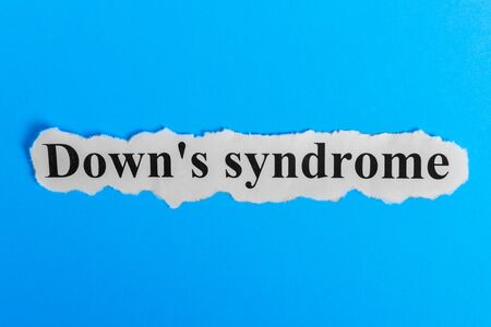 incontinence: Down syndrome text on paper. Word Down syndrome on a piece of paper. Concept Image. Down syndrome Syndrome. Stock Photo