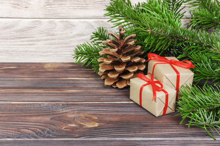 Christmas presents under a tree. Fir branches. Xmas and Happy New Year composition.