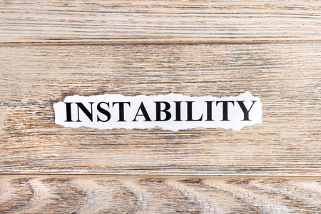 INSTABILITY text on paper. Word INSTABILITY on torn paper. Concept Image. Stock Photo