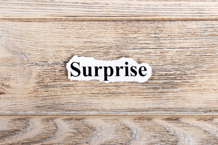 Surprise text on paper. Word Surprise on torn paper. Concept Image. Stock Photo - 87815487