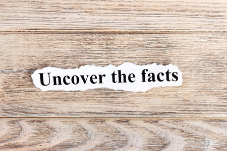 Uncover The Facts text on paper. Word Uncover The Facts on torn paper. Concept Image.