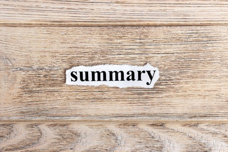 Summary text on paper. Word Summary on torn paper. Concept Image.