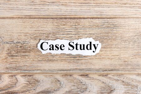 Case Study text on paper. Word Case Study on torn paper. Concept Image.