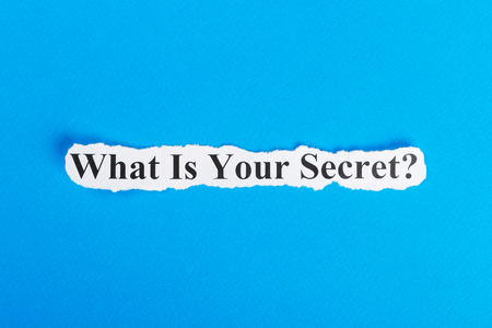 What Is Your Secret text on paper. Word What Is Your Secret on torn paper. Concept Image.