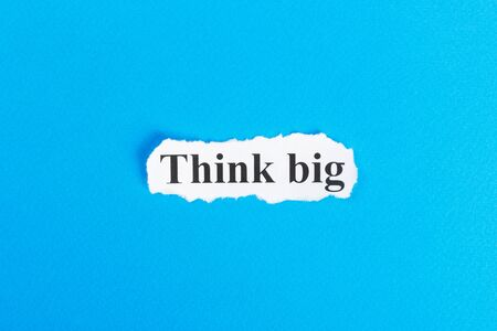 smart goals: Think Big text on paper. Word Think Big on torn paper. Concept Image.