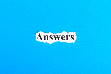 answers text on paper. Word answers on torn paper. Concept Image. Stock Photo