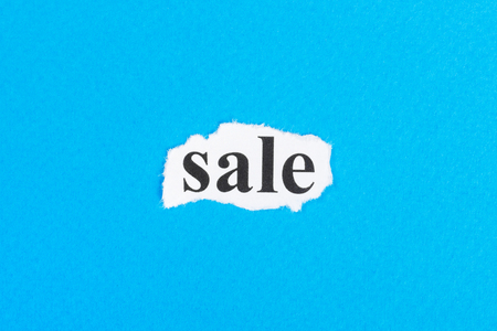 sale text on paper. Word sale on torn paper. Concept Image.