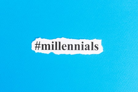Millennials text on paper. Word Millennials on torn paper. Concept Image.