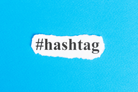 Hashtag text on paper. Word Hashtag on torn paper. Concept Image. Stock Photo