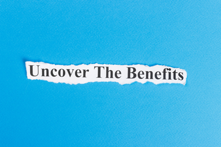 Uncover The Benefits text on paper. Word Uncover The Benefits on torn paper. Concept Image.