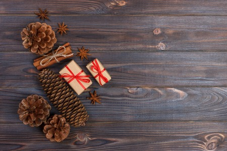 Natural Christmas Accessories Pine Cones Wooden Star Decorated Linen Cord Cinnamon Vintage Gifts on Wooden Background.