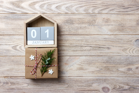 Christmas calendar. Christmas gift, fir branches on wooden white background. Copy space, top view. Stock Photo