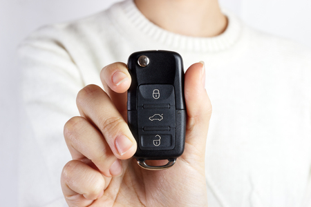 Car Keys. Seller hand giving keys. girl with car keys. Stock Photo