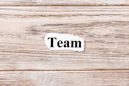 TEAM of the word on paper. concept. Words of TEAM on a wooden background. Stock Photo
