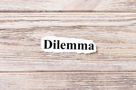 DILEMMA of the word on paper. concept. Words of COMBINE on a wooden background. Stock Photo