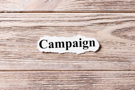 Campaign of the word on paper. concept. Words of Campaign on a wooden background. Stock Photo
