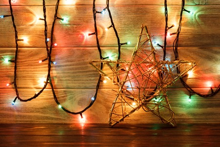 stock photo vintage christmas decoration with stars and lights on wooden table