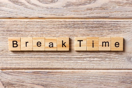 Break time word written on wood block. Break time text on table, concept.