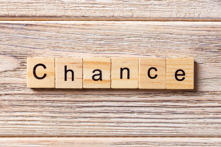 CHANCE word written on wood block. CHANCE text on table, concept. Stock Photo