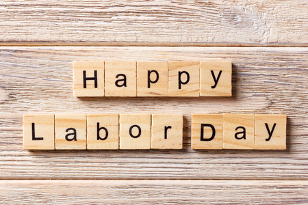 Happy Labor Day word written on wood block. Happy Labor Day text on table, concept. Stock Photo