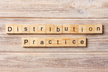 distribution practice word written on wood block. distribution practice text on table, concept. Imagens