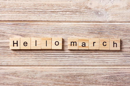 Hello March word written on wood block. Hello March text on table, concept. Foto de archivo