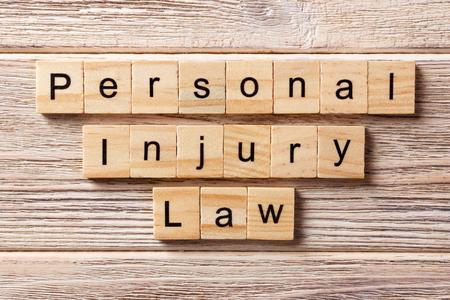 personal injury law word written on wood block. personal injury law text on table, concept.