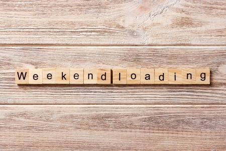 Weekend Loading word written on wood block. Weekend Loading text on table, concept.