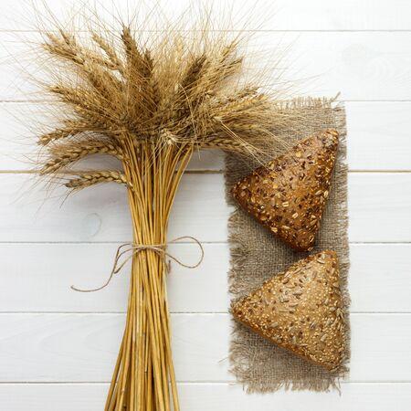 Close up rye multigrain bread on wood white baackground. Stock Photo
