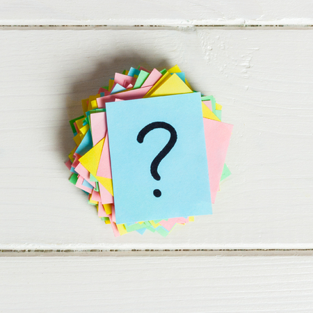 Concept for confusion, question or solution. question mark on wooden background. Stock Photo