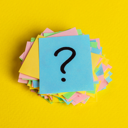 Just a lot of question marks on colored papers. Stock Photo