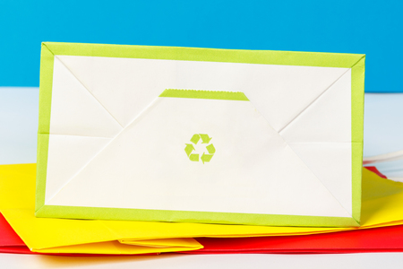 Green recycle symbol on the underside of the paper bag. Stock Photo
