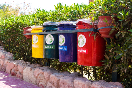 old Colorful Recycle Bins In The Park. urns for separate collection of garbage. Stock Photo