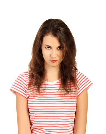 Picture of angry young woman. emotional girl isolated on white background. Stock Photo
