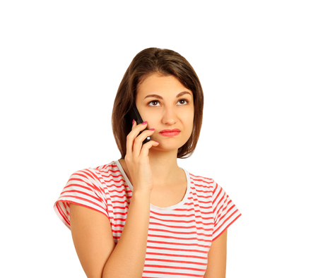 disgruntled girl talking on mobile phone. look with perplexity. emotional girl isolated on white background.