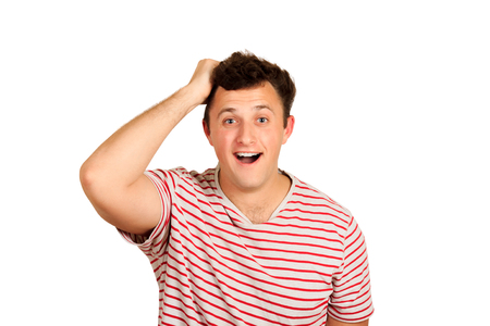 shocked and surprised man smiles into the camera. emotional guy isolated on white background. Stock Photo